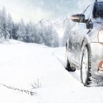 car driving in harsh winter weather